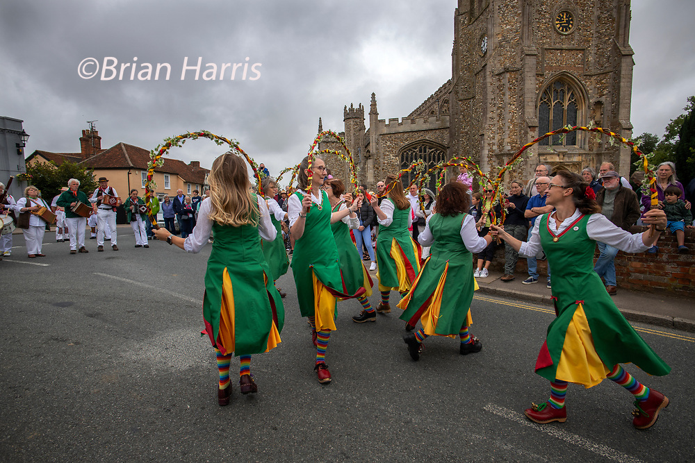 Thaxted Essex_Morris Dancing_August Bank Holiday Monday_photo Brian Harris_30 Aug 2021<br />Dancing in the Bull Ring and Thaxted Church Yard.<br />Seen here: Chelmsford Morris Ladies who dance in the 'North West Clog' tradition dancing for the first time in Thaxted.