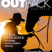Mountain cattle man, Jack McCormack tends to his horse atop at rise in the Victorian High country