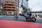 Tokyo, Shibuya crossing - A customised Harley Davidson as chopper in Shibuya