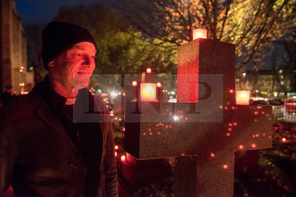 """© Licensed to London News Pictures. 16/11/2019. Bristol, UK. Canon NICK HAY, priest-in-charge of St Paul's Church. """"Light the Night"""" in the grounds of St Paul's Church churchyard on Coronation Road with a sea of light as 5,000 candles are lit for the inaugural Light the Night event. Shielded candles were placed around the churchyard by volunteers to create a event for everybody to come and celebrate family and remembrance of loved ones. Attendees could buy and light a candle in remembrance of their loved ones. The event was inspired by the celebrations of All Souls Day and the tradition of Eastern European churches. Photo credit: Simon Chapman/LNP."""