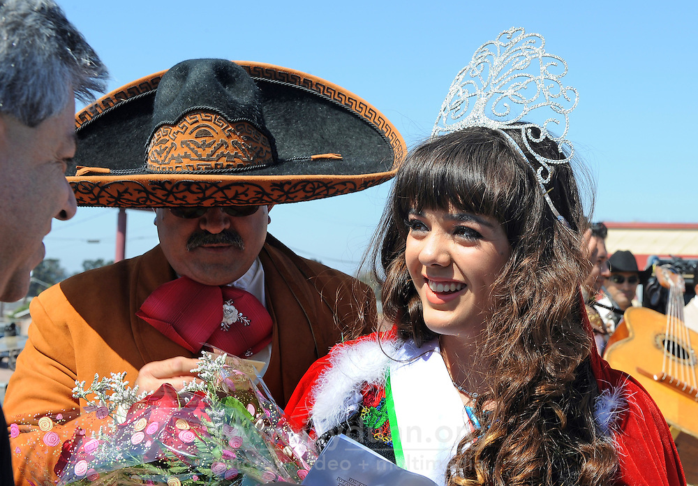 """New """"El Grito"""" Queen Raquel Velasquez, 16, after being crowned by Carlos Ponce Martinez, left, consul general of Mexico to San Jose. Sunday's celebration in Salinas marked September 16th's anniversary of Mexico's independence from Spain. The annual fiesta, which occupies East Alisal Street between Wood and Sanborn, brimmed as usual with booths selling patriotic souvenirs and all manner of food and drink. Local businesses and nonprofits manned booths with information about health and community programs, while traditional """"bandas"""" filled the afternoon with dance music and good cheer."""