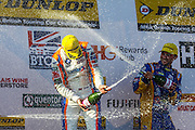 Sam Tordoff (winner) and Andrew Jordan podium celebrations of round 12 of the Dunlop MSA British Touring Car Championship at Oulton Park, Budworth, Cheshire, United Kingdom on 7th June 2015. Photo by Aaron Lupton.
