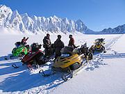 Alaska, Valdez, Heiden Glacier, The Books.  A group of snowmachine skiers decides where to ski next.