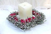 Flower Arrangement with candle on white