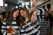 Two Japanese women, dressed as prisoners during the Halloween celebrations in Shibuya, Tokyo, Japan. Saturday October 29th 2016 Halloween celebration in Japan have grown massively in the last few years. To ensure the safety of the crowds in Shibuya this year, the police closed several roads leading to the famous Hachiko Square, allowing costumed revellers to spread over a larger area.