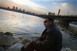 Wael Lutsi, a columnist for a local Egyptian newspaper, is seen on the banks of the Nile River, Cairo, Egypt, Dec. 28, 2005. Lutsi is a critic of Islamic televangelist Amr Khaled, who  had previously been asked to leave Egypt as his revival gained strength. As a result, Khaled started preaching on several television shows, turning him into an international celebrity. Some religious scholars complain that Khaled has not been properly trained in Islam to command such a following.