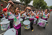 The Timbao drum band at the start - The Sunday of the Notting Hill Carnival. The annual event on the streets of the Royal Borough of Kensington and Chelsea, over the August bank holiday weekend. It is led by members of the British West Indian community, and attracts around one million people annually, making it one of the world's largest street festivals.