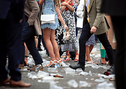 Racegoers are surrounded by rubbish during Ladies Day of the 2018 Randox Health Grand National Festival at Aintree Racecourse, Liverpool.