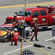 NASCAR Sprint Cup driver Tony Stewart (14)  walks from his crashed race car during the 56th Annual NASCAR Coke Zero 400 race at Daytona International Speedway on Sunday, July 6, 2014 in Daytona Beach, Florida.  (AP Photo/Alex Menendez)