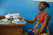 Rita Sahi, 25, who is 7-month pregnant with her third child, gets a prescription for malaria prophylaxis from a midwife during a prenatal consultation at the Libreville health center in Man, Cote d'Ivoire on Wednesday July 24, 2013.
