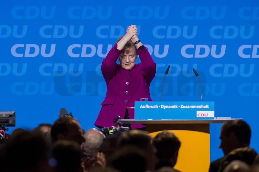 26 FEB 2018, BERLIN/GERMANY:<br /> Angela Merkel, CDU, Bundeskanzlerin, nimmt nach ihrer Rede den Applaus der Delegierten entgegen, CDU Bundesparteitag, Station Berlin<br /> IMAGE: 20180226-01-091<br /> KEYWORDS: Party Congress, Parteitag