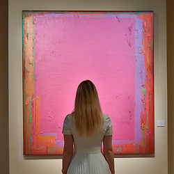 """© Licensed to London News Pictures. 28/06/2017. London, UK.  A visitor views """"20.5.74"""" by John Hoyland.  Preview day at Masterpiece London, a leading art fair held in Chelsea, bringing together 150 international exhibitors presenting works from antiquity to the present day.  The event runs 29 June to 5 July 2017.   Photo credit : Stephen Chung/LNP"""