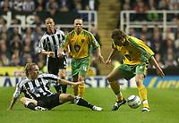 Photo. Glyn Thomas. <br /> Newcastle United v Norwich City. Barclays Premiership.<br /> 25/08/2004.<br /> Norwich Darren Huckerby (R) shields the ball from a helpless Craig Bellamy (L)