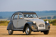 2CV, Deux Chevaux car in beach car park Brancaster, Norfolk, United Kingdom