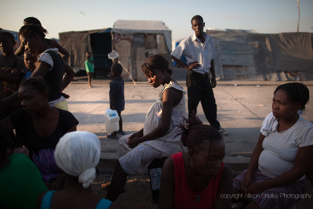 Sixteen-year-old Fedya sits with other pregnant women in front of the shelter of the local midwife Benite in the La Piste tent camp in Port-au-Prince, Haiti, March 24, 2011.  Fedya chose to stay in Port-au-Prince when her family fled the city after the January 2010 earthquake.  She lives in a one-room tin hut with a family friend, that friend's husband and the friend's young son.