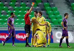 Damir Skomina, referee with yellow and red card for Dalibor Teinovic of Domzale talks to Luka Elsner and Damir Pekic of Domzale during football match between NK Domzale and NK Maribor in final match of Hervis Cup, on May 25, 2011 in SRC Stozice, Ljubljana, Slovenia. Domzale defeated Maribor and became Slovenian Cup Champion 2011. (Photo By Vid Ponikvar / Sportida.com)