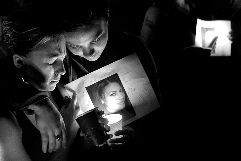Latanya Thomas, left, and Jessenia Cardenas bow their heads during a candlelight vigil for their friend, Tiairra Garcia, at Volunteer Park in Pasco on Aug. 24, 2008. Around 100 attended the vigil for Garcia, who has been missing since June 22. Garcia's was recovered on July 28, 2009. Her boyfriend, Marnicus Lockhard, pled guilty to second-degree manslaughter and was sentenced to 8 years.