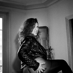 Carmina, a French cam girl, adult performer, alternative modele, posing in an apartment in the 18th arrondissement. Paris, France. January 20, 2018. Self-assignment.<br /> Carmina, une cam girl, performeuse francaise, et modele alternative, pose dans un appartement du 18eme arrondissement. Paris, France. 20 Janvier 2018. Self-assignment.