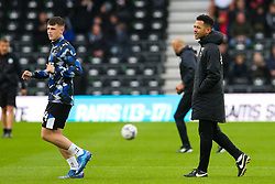 Derby County assistant manager Liam Rosenior and Derby County's Jack Stretton on the pitch ahead of the Sky Bet Championship match at Pride Park, Derby. Picture date: Saturday October 2, 2021.