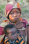 Portrait of a young Hadza mother with her baby, Hadza or Hadzabe is a small tribe of hunter gatherers. Photographed at Lake Eyasi, Tanzania