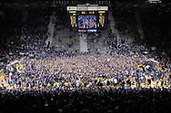 Kansas State Wildcat fans storm the floor after upsetting the Kansas Jayhawks 84-75 for the first time at home since 1983 at Bramlage Coliseum in Manhattan, Kansas.