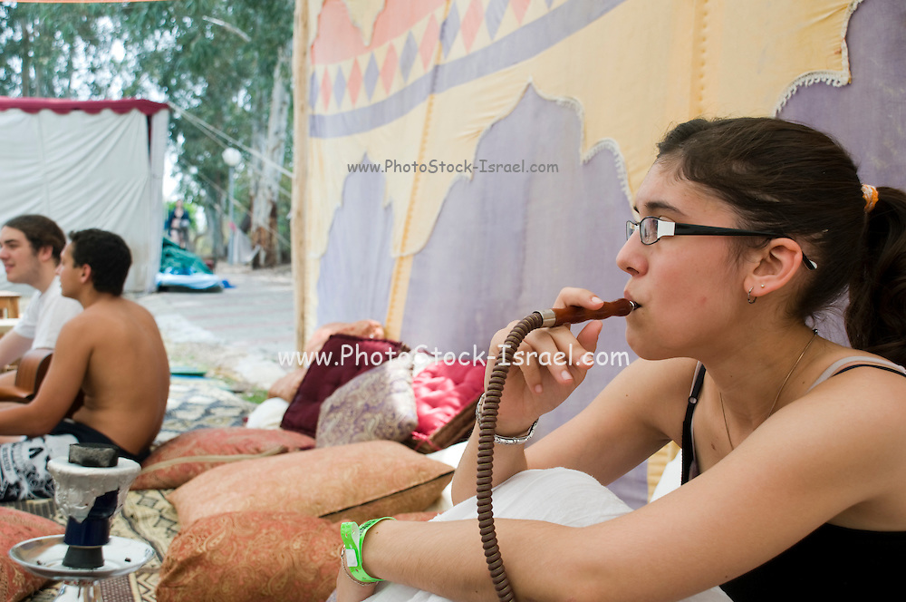Female teen smoking a Nargileh