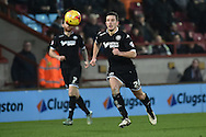 Jason Pearce of Wigan Athletic  during the Sky Bet League 1 match between Scunthorpe United and Wigan Athletic at Glanford Park, Scunthorpe, England on 2 January 2016. Photo by Ian Lyall.