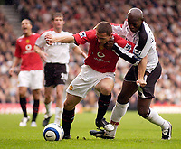 Photo: Daniel Hambury.<br />Fulham v Manchester United. The Barclays Premiership. 01/10/2005.<br />Fulham's Luis Boa Morte gets his hands round the neck of Manchester Utd's Phil Bardsley.