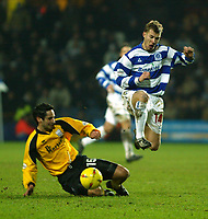 Photo. Chris Ratcliffe<br /> QPR v Rushden & Diamonds. Nationwide Division 2. 03/01/2004<br /> Martin Rowlands of QPR goes past Andy Sambrook in yesterday's 1-0 win