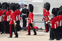 A Guardsman on a stretcher after fainting during the Trooping the Colour ceremony at Horse Guards Parade, central London, as the Queen celebrates her official birthday.