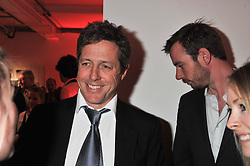 HUGH GRANT at a dinner in aid The Journalism Foundation held at Philips De Pury & Company, Howick Place, London, SW1 on 22nd May 2012.