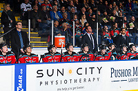 KELOWNA, CANADA - NOVEMBER 21:  Assistant coach Kris Mallette, head coach Adam Foote and assistant coach Travis Crickard stand on the bench behind the Kelowna Rockets against the Regina Pats on November 21, 2018 at Prospera Place in Kelowna, British Columbia, Canada.  (Photo by Marissa Baecker/Shoot the Breeze)