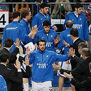Anadolu Efes's Kerem Tunceri (C) during their Turkish Basketball League match Anadolu Efes between Erdemir at Arena in Istanbul, Turkey, Wednesday, January 28, 2012. Photo by TURKPIX