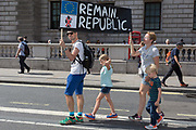 A family of Pro-EU Remain protesters march to Stop the Coup in Whitehall, near Downing Street, at the end of a week that saw Prime Minister Boris Johnson ask Queen Elizabeth for permission to suspend prorogue the British Parliament during the final stages of his Brexit negotiations with the European Union, in Brussels, on 31st August 2019, in Westminster, London, England.