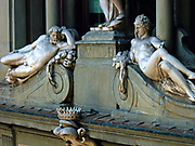Statue located outside of the Uffizi museum in Florence, Italy. One of the oldest art museums in the Western World. A soldier stands above 2 reclining nudes.