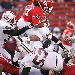 Oct 10, 2009; Piscataway, NJ, USA; Rutgers running back De'Antwan Williams (34) jumps over the pile during second half NCAA college football action in Rutgers' 42-0 victory over Texas Southern at Rutgers Stadium.