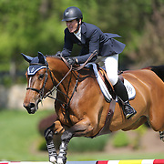 Mclain Ward riding HH Azur in action during the $100,000 Empire State Grand Prix presented by the Kincade Group during the Old Salem Farm Spring Horse Show, North Salem, New York,  USA. 17th May 2015. Photo Tim Clayton