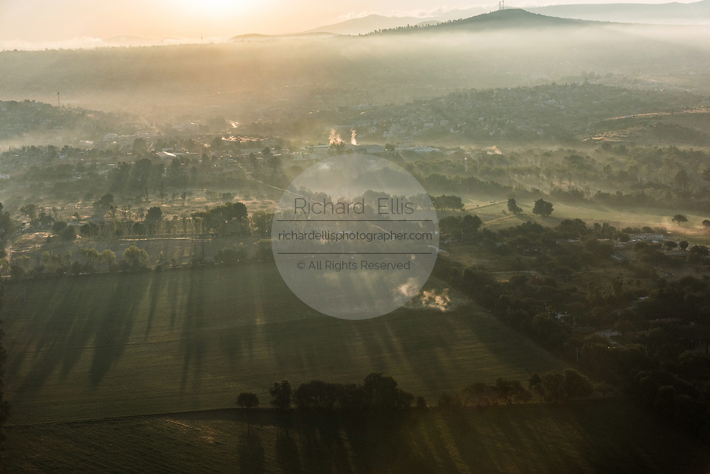 Fog rises over the farmland at sunrise outside the colonial city of San Miguel de Allende, Mexico.