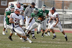 10 November 2007:  Marcus Dunlop carries the ball through traffic. This game between the Wheaton College Thunder and the Illinois Wesleyan University Titans was for a share of the CCIW Championship and was played at Wilder Field on the campus of Illinois Wesleyan University in Bloomington Illinois.