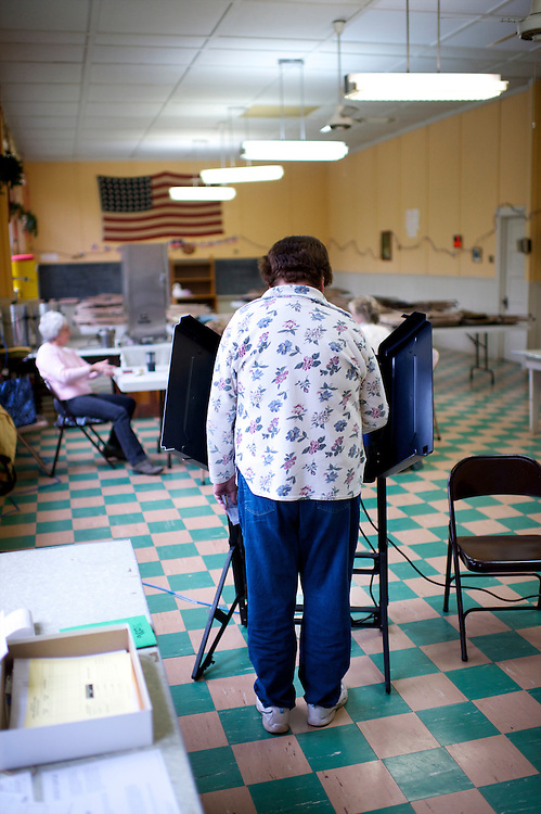 A Pennsylvania voter casts her ballot on the day of the Republican presidential primary at the Sugarloaf Memorial Building, a former township schoolhouse, in Grassmere, Pa., on April 24, 2012.