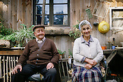 An elderly couple outside their wooden house in Horcon, Chile.