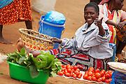 A vendor sits by her produce at Buhongwa market near Mwanza, Tanzania on Monday December 14, 2009.