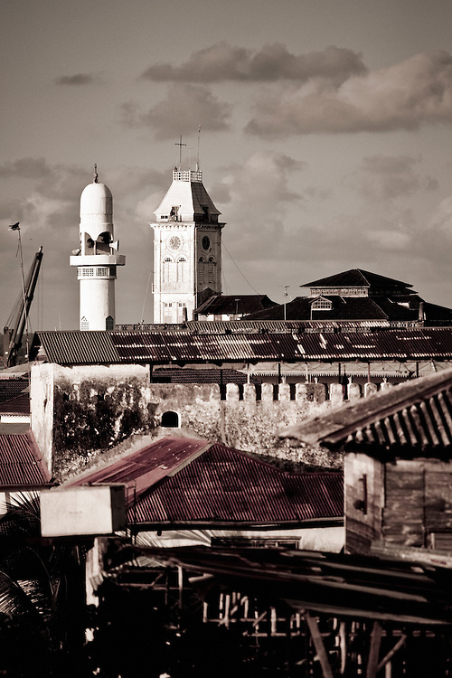 """Stone Town, Zanzibar 06 November  2010<br /> View of the tower of Beit al-ajaib or """"House of Wonders"""". Zanzibar's best-known historic building. Built as a ceremonial and administrative palace by Sultan Barghash in 1883. Now a National Museum. Stone Town or Mji Mkongwe, in Swahili meaning """"ancient town"""", is the old part of Zanzibar City, the capital of the island of Unguja, informally known as Zanzibar, part of Tanzania. The town was the centre of trade on the East African coast between Asia and Africa before the colonization of the mainland in the late 19th century after which the focus moved to Mombasa and Dar es Salaam.  From 1840 to 1856, Said bin Sultan had the capital of the Omani Empire in Stone Town. The main export was spices and particularly cloves. For many years Stone Town was a major centre for the slave trade; slaves were obtained from mainland Africa and traded with the Middle East. The town also became a base for many European explorers, particularly the Portuguese, and colonizers from the late 19th century. David Livingstone used Stone Town as his base for preparing for his final expedition in 1866. A house, now bearing his name, was lent by Sultan Seyyid Said. Immigrant communities from Oman, Persia and India lived here. <br /> Photo: Ezequiel Scagnetti"""