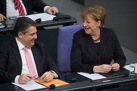 17 FEB 2016, BERLIN/GERMANY:<br /> Sigmar Gabriel (L), SPD, Bundeswirtschaftsminister, und Angela Merkel, CDU, Bundeskanzlerin, nach Merkels Regierunsgerklaerung der zum Europaeischen Rat, Plenum, Deutscher Bundestag<br /> IMAGE: 20160217-03-033<br /> KEYWORDS: Debatte, freundlich, lachen, lacht