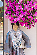 A mannequin of a Native American woman to attract tourists at a shop along 4th Avenue in downtown Anchorage, Alaska.