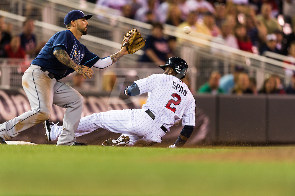 Denard Span (2) of the Minnesota Twins slides safely into 3rd base during a game against the Tampa Bay Rays on August 10, 2012 at Target Field in Minneapolis, Minnesota.  The Rays defeated the Twins 12 to 6.  Photo: Ben Krause