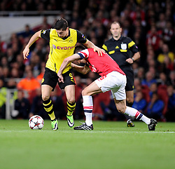 Arsenal's Laurent Koscielny tries to tackle Borrusia Dortmund's Robert Lewandowski  - Photo mandatory by-line: Alex James/JMP - Tel: Mobile: 07966 386802 22/10/2013 - SPORT - FOOTBALL - Emirates Stadium - London - Arsenal v Borussia Dortmund - CHAMPIONS LEAGUE - GROUP F