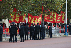 © Licensed to London News Pictures. 20/10/2015. London, UK. Police stand guard supporters of Chinese President Xi Jinping in The Mall ahead of a four day State Visit to the United Kingdom. Photo credit: Peter Macdiarmid/LNP