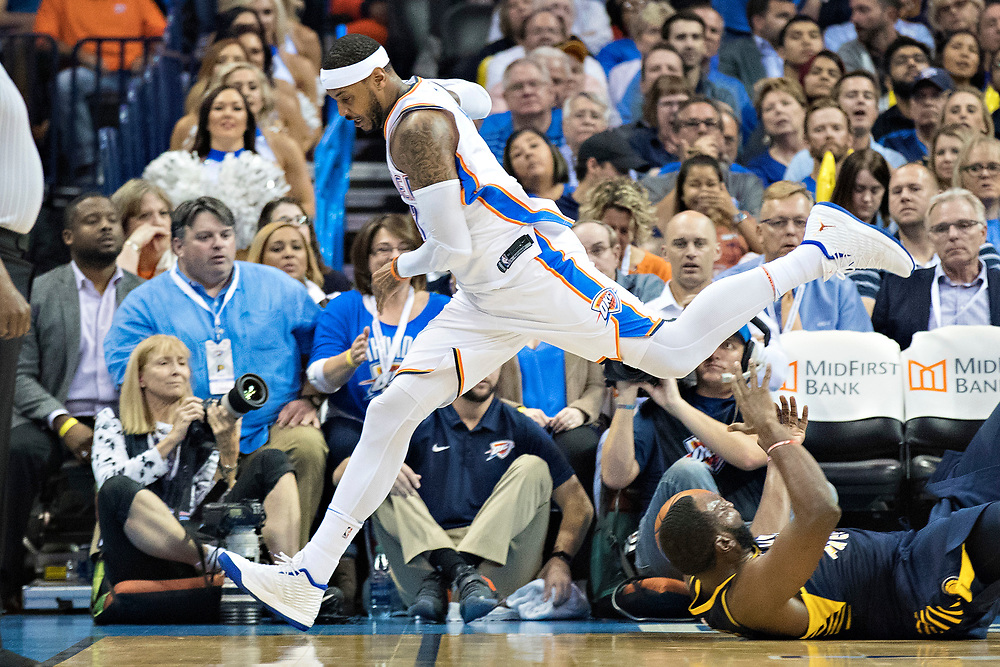 OKLAHOMA CITY, OK - OCTOBER 25:  Carmelo Anthony #7 of the Oklahoma City Thunder goes after a loose ball during a game against the Indiana Pacers at the Chesapeake Energy Arena on October 25, 2017 in Oklahoma City, Oklahoma.  NOTE TO USER: User expressly acknowledges and agrees that, by downloading and or using this photograph, User is consenting to the terms and conditions of the Getty Images License Agreement.  The Thunder defeated the Pacers 114-96.  (Photo by Wesley Hitt/Getty Images) *** Local Caption *** Carmelo Anthony