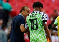 Football - 2018 International Friendly (pre-World Cup warm-up) - England vs. Nigeria<br /> <br /> Nigeria Head Coach Gernot Rohr talks to Alex Iwobi (Nigeria) as they leave the pitch at Wembley Stadium.<br /> <br /> COLORSPORT/DANIEL BEARHAM